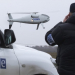 A member of the Organization for Security and Co-operation in Europe (OSCE) mission to Ukraine watches a drone take off during a test flight near the town of Mariupol, eastern Ukraine, Thursday, Oct. 23, 2014. The OSCE Unmanned Aerial Vehicles (UAVs) will be used by the OSCE mission to monitor a Moscow-backed truce deal between Ukraine and pro-Russian separatists in the Donetsk region. (AP Photo/Dmitry Lovetsky)